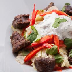 Теплый салат с куриной печенью с заправкой из мацони и кинзы из ресторана ОТТО